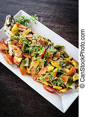 asian grilled fish with sweet and sour vegetables