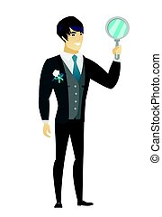 Asian groom in a wedding suit holding a hand mirror. Full length of groom looking at himself in a hand mirror. Groom with hand mirror. Vector flat design illustration isolated on white background.