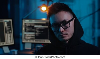 asian hacker in dark room with computers at night -...