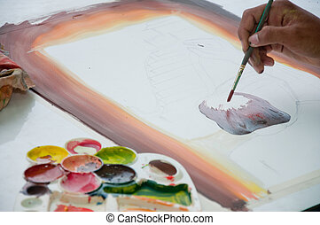 asian hand painter painting water color picture