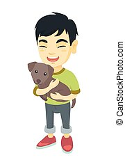 Asian happy boy holding a dog.