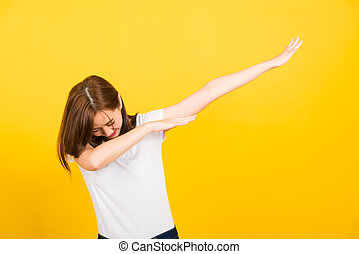 woman teen smile standing wear t-shirt move showing DAB dance against gesture
