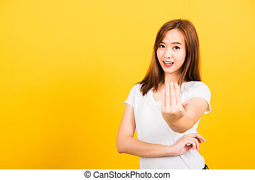 woman teen smile standing wear white t-shirt making gesture hand inviting to come