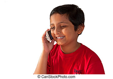 Asian, Indian, Bengali young boy talking on mobile phone, smiling, isolated, white background