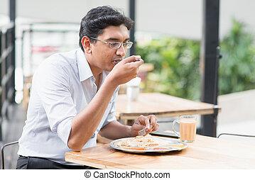 Indian business man eating food
