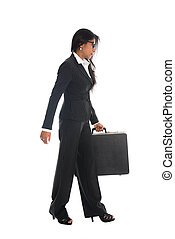 asian indian business woman full length walking with a suitcase isolated in white background