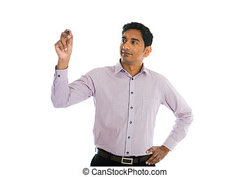 Asian Indian businessman in black suit writing something on glass board with marker