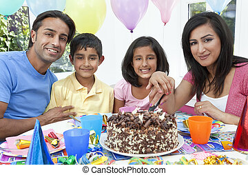 Asian Indian Family Celebrating Birthday Party Cutting the...