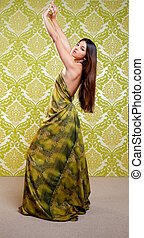 Asian Indian woman dancing with ethnic dress