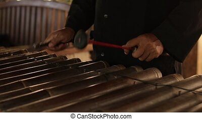 Asian Indonesian Balinese musician gamelan instrument....
