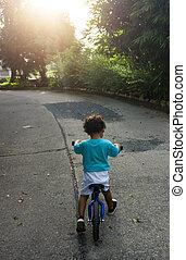 Asian kid first day play balance bike. Little boy learning...