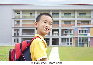 Asian kid happy to go to school - asian boy elementary...