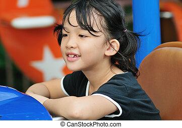 Asian kid in amusement park
