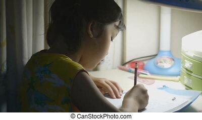 Asian kid learning - Little Asian kid doing her homework