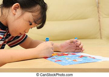 Asian kid painting at home
