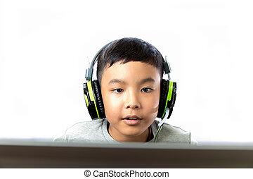Asian kid play computer games