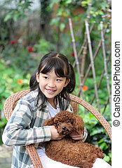 Asian kid playing with dog