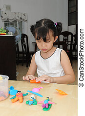 Asian kid playing with dough - An asian kid playing with ...