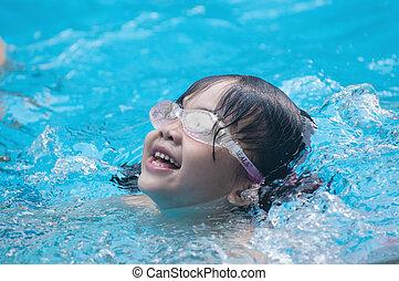 Asian kid swimming
