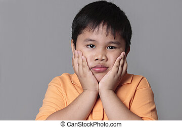 asian kid very sad