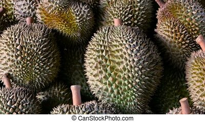 Asian king of fruits Durian is on the counter in the night market in Thailand