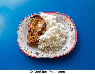 Asian kitcken, Fried Chicken with white Rice on the plate