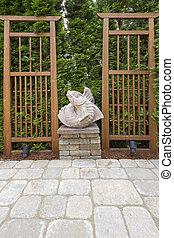 Asian Koi Fish Sculpture in Garden Backyard