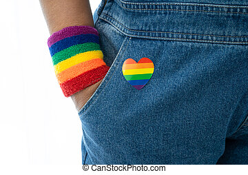 Asian lady wearing rainbow flag wristbands, symbol of LGBT pride month celebrate annual in June social of gay, lesbian, bisexual, transgender, human rights.
