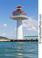 Asian lighthouse over the coastline
