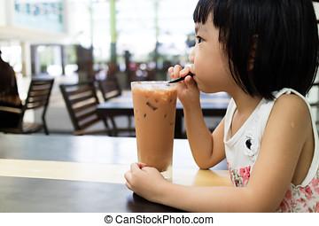 Asian Little Chinese Girl Drinking Ice Milk Tea