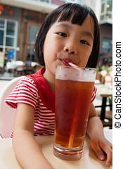 Asian Little Chinese Girl Drinking Ice Tea