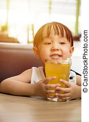 Asian little Chinese girl drinking lemon tea
