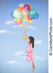 Asian little Chinese girl flying with colorful balloons
