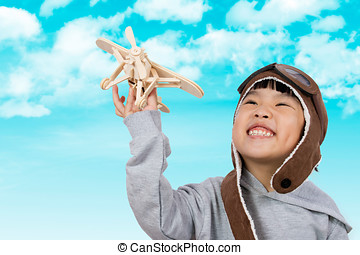 Asian Little Chinese Girl Playing with Toy Airplane