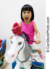 Asian Little Chinese Girl Riding on a Horse
