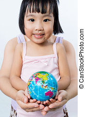 Asian Little Girl and Adult Holding a World Globe in Hands