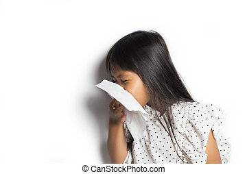 Asian little girl blows her nose, isolated on white background