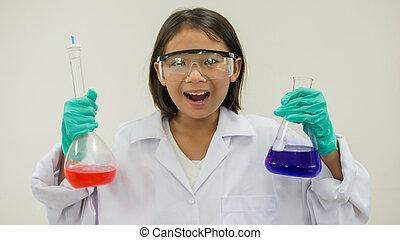 Asian little girl holding test tube