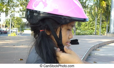 Asian little girl Smile with happiness wearing sport safety helmet