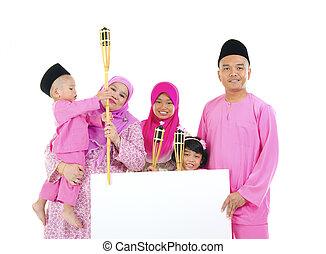 asian malay family during raya with blank cardboard