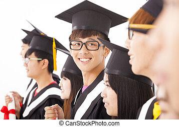 asian male college graduate at graduation with classmates