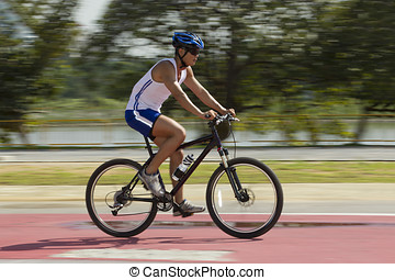 Cyclist training on a road - Asian male Cyclist training on...