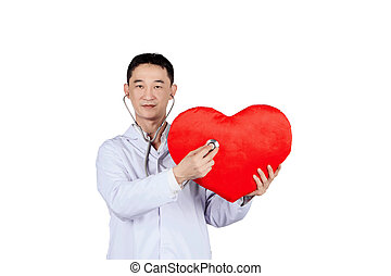 asian male doctor auscultation a red heart with a stethoscope, isolated on white