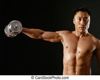 Asian male doing single shoulder fly