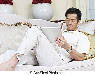 asian businessman working from home.
