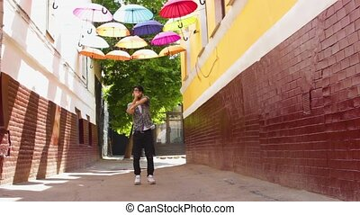 Asian man dancing outdoor in summer day under colorful...