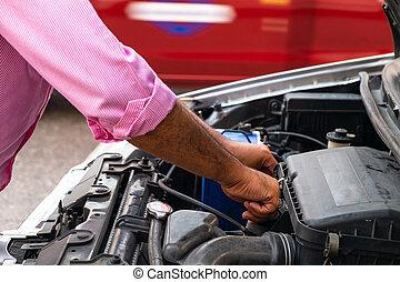 Asian Man Fixing and Repair Broken Car Beside the Local Road