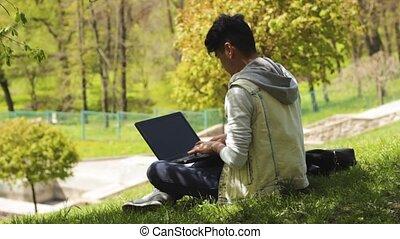Asian man freelancer working on laptop