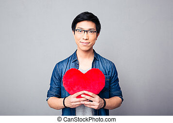 Asian man holding red heart