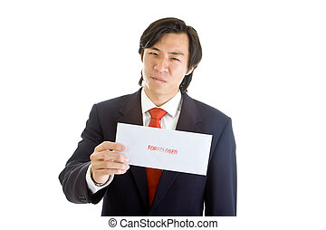 Asian man in a suit holding foreclosure notice with pained/angry expression